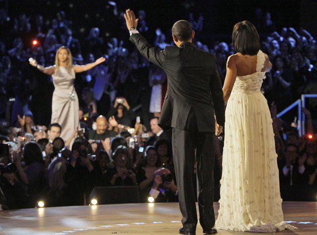 Barack Obama and Michelle Obama wave to Beyonce
