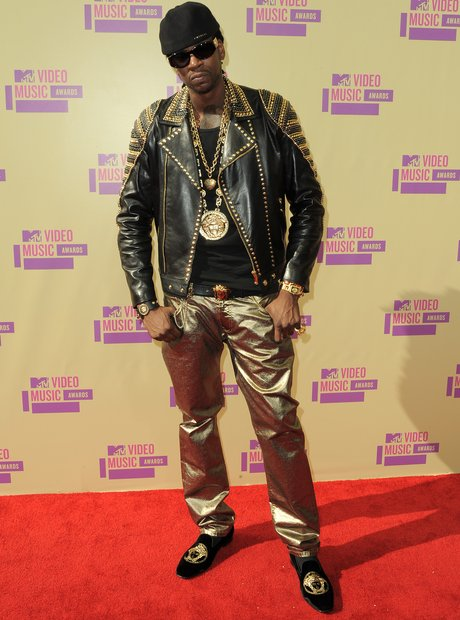 2 Chainz wearing gold trousers