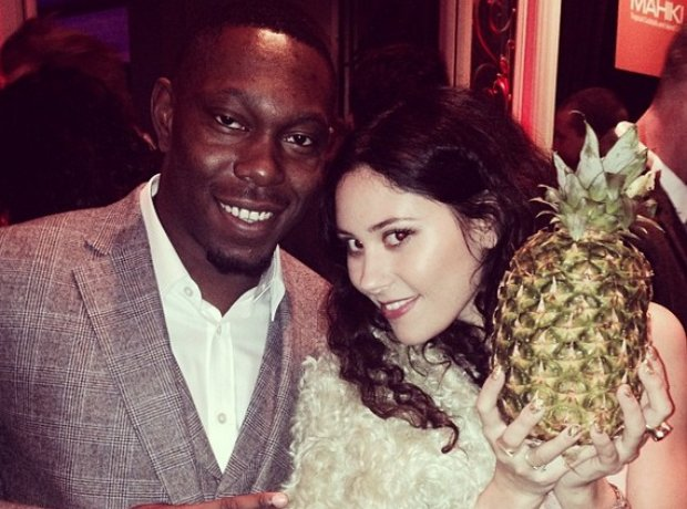Eliza Doolittle holding a pineapple during a picture with Dizzee Rascal
