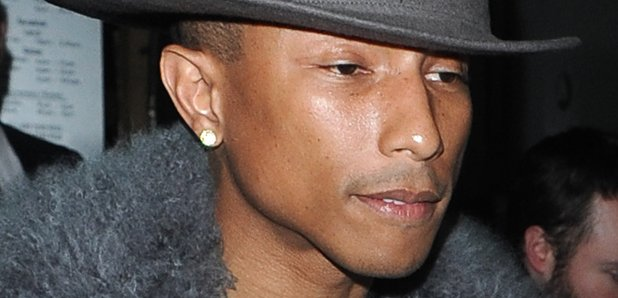 Pharrell Williams wears another big hat