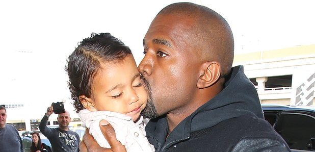 Kanye West Kissing North