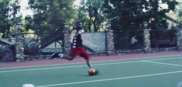 Drake kicking football