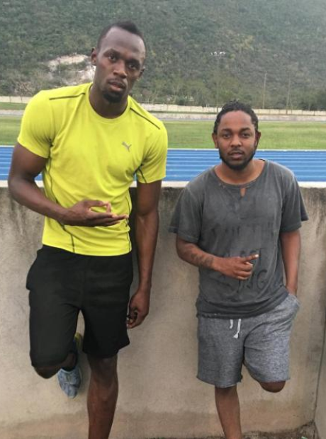 Kendrick Lamar and Usain Bolt at running track