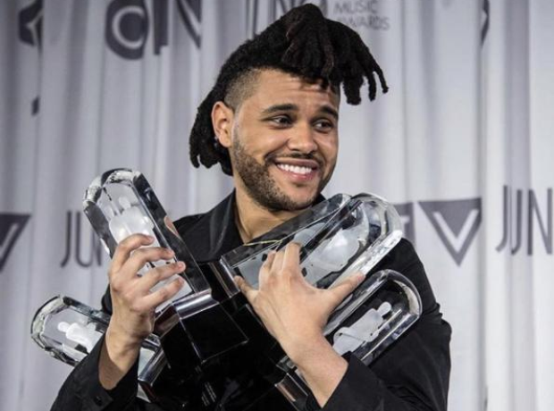 The Weeknd holding Juno Awards
