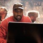 Kanye West Looking At Laptop