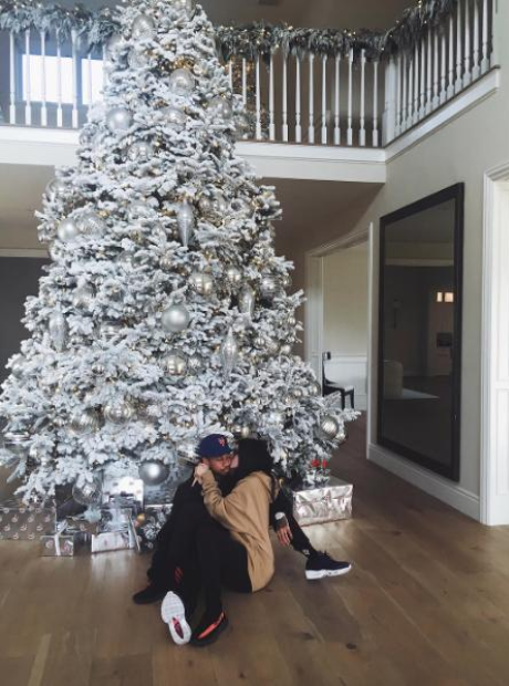 Kylie Jenner and Tyga under a Christmas tree